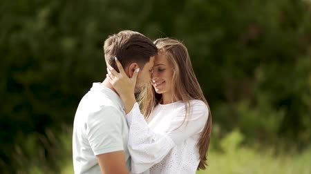 meghittség : Love Kiss. Beautiful Couple Kissing In Nature. Happy Woman Meeting Handsome Young Man On Romantic Date And Kissing Him. People Dating, Sharing Passionate Kiss Outdoors. Relationship.