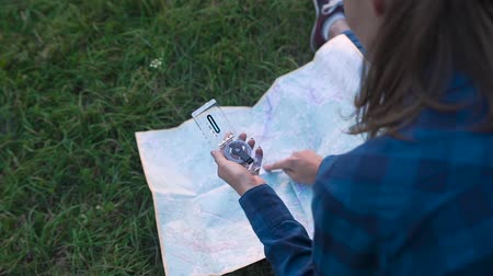 направление : Woman Traveling, Using Map And Compass, Searching For Road Using Travel Equipment In Nature.