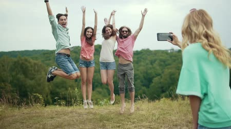 memories photos : Friends Jumping And Having Fun While Taking Photos On Phone Outdoors In Nature.