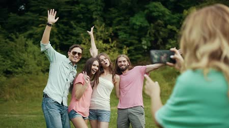 memories photos : Happy Friends Taking Photos On Phone In Nature, Having Fun And Laughing On Weekend Outdoors. Stock Footage