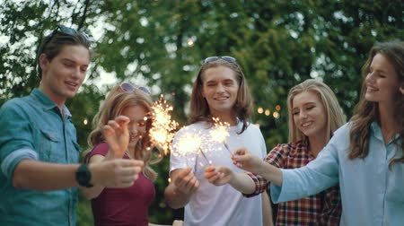 fireworks : Happy Friends With Sparklers Having Fun Outdoors, Cheerful People Enjoying Party In Park.
