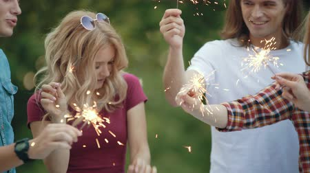 sparklers : Happy Friends With Sparklers Having Fun Outdoors, Cheerful People Enjoying Party In Park.