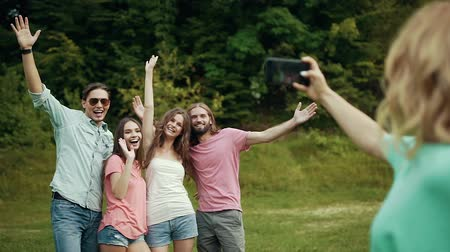 memories photos : Happy Friends Taking Photos On Phone In Nature.