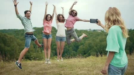 memories photos : Friends Jumping And Having Fun While Taking Photos In Nature Stock Footage