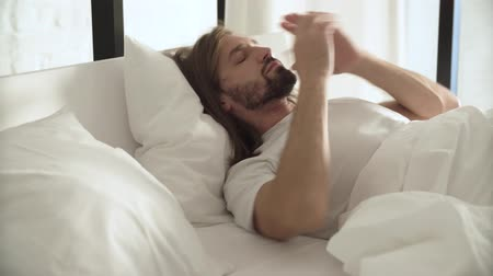 wakeup : Wake Up. Man Sleeping In Bed With Phone Alarm Stock Footage
