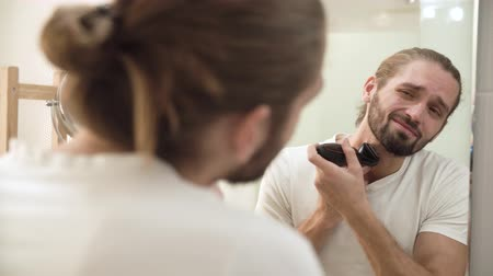 инструмент : Men Face Hygiene. Man Shaving Beard And Feeling Painful