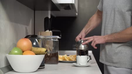 brew coffee : Man Pouring Coffee Into Cup At Modern Kitchen