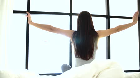 пробуждение : Morning Waking Up. Woman Sitting On Bed And Stretching