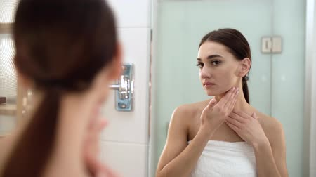 empresárias : Skin Care. Woman Touching Face And Looking At Mirror At Bathroom