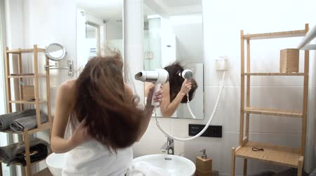 kurutma : Hair Care. Woman Drying Long Hair With Hairdryer At Bathroom
