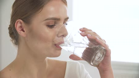 hydro : Woman Drinking Water From Glass And Looking At Camera Stock Footage