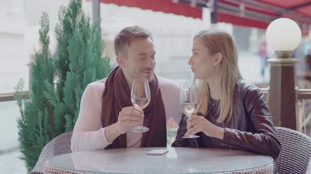 white wine : Couple On Date Drinking Wine In Cafe Outdoors