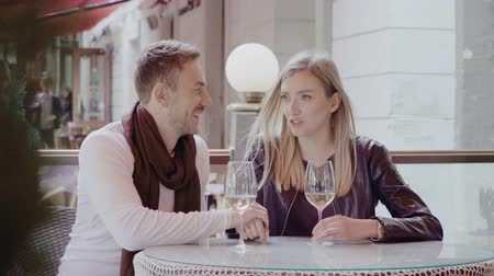 white wine : Couple Drinking Wine And Having Fun Together At Restaurant Outdo Stock Footage