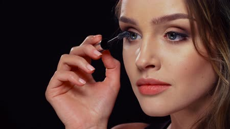 beauty products : Eye Makeup. Beautiful Woman Applying Mascara On Lashes