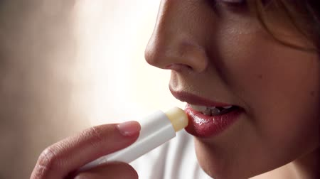 увлажняющий : Lips Care. Woman Applying Protection Lip Balsam Closeup