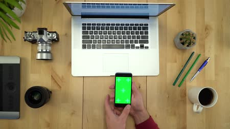 netbook : Man Using Phone With Green Screen, Working At Table Flat Lay
