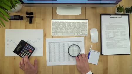 magnifier : Business Man Working With Documents At Financial Office Flat Lay Stock Footage