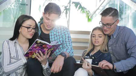 synopsis : Students Studying, Reading Educational Book In College Stock Footage