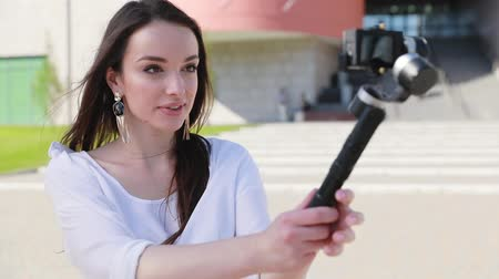 vlogging : Blogging. Woman Filming Video On Camera On Street