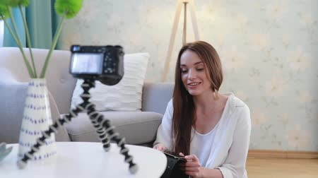 social influence : Video Blogging. Woman Blogger Filming On Camera At Home Stock Footage