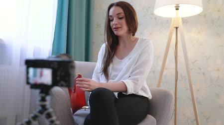 social influence : Fashion Blogger Filming Video On Camera At Home Stock Footage
