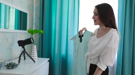 social influence : Video Blogging. Woman Blogger Filming Fashion Clothes On Camera