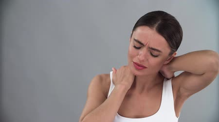 nerves : Neck Pain. Tired Woman With Painful In Neck Muscles
