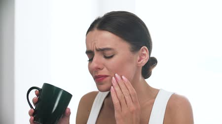 hassaslık : Sensitive Teeth. Woman Drinking And Feeling Tooth Pain