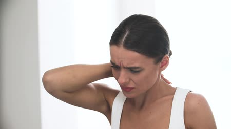 discomfort : Neck Pain. Tired Woman With Painful In Neck Muscles