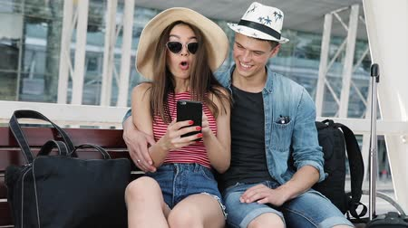 busz : Traveling. Couple Using Phone, Waiting Transport Near Airport