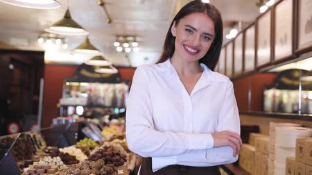 vendedora : Store With Chocolate Sweets. Smiling Saleswoman Near Showcase