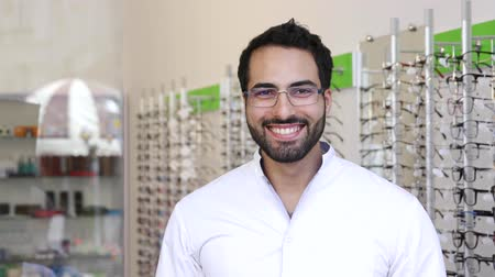 ophthalmologist : Optician Doctor Near Showcase With Eyeglasses At Glasses Shop