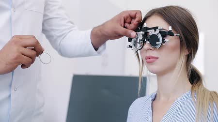 тестирование : Eye Exam. Woman In Glasses Checking Eyesight At Clinic Стоковые видеозаписи