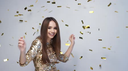 fryzura : Celebration. Happy Woman Dancing With Confetti On White Wideo