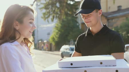 workman : Pizza Delivery. Courier Delivering Box With Food To Client, Woman Paying Order Outdoors Stock Footage