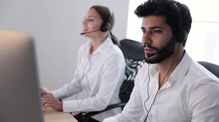 garniture : Contact Center Agent Consulting Customers Online. Man And Woman Working On Helpline In Call-Center