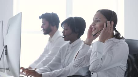 dispatcher : Call center. Smiling Woman In Headset Working At Computer Stock Footage
