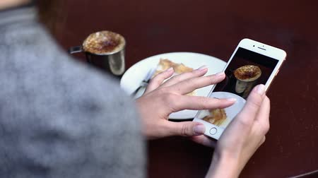 блог : Food Photography. Woman At Cafe Watching Photos On Phone Closeup