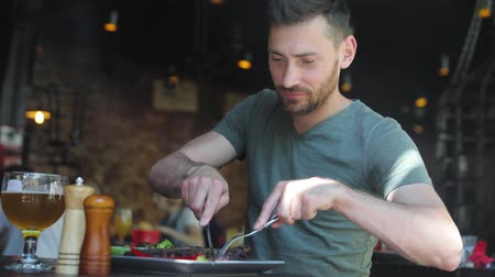 barbecued : Man Eating Food At Restaurant