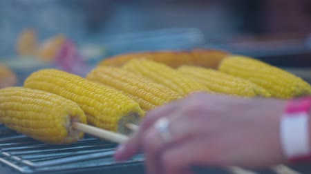 barbequing : Grilling Vegetables. Cooking Corn On Grill Closeup, Grilled Corn Cobs On Skewers