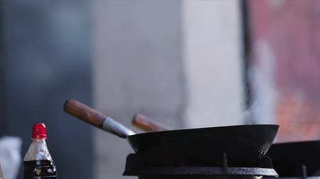 wok food : Cooking Food. Wok On Stove With Fire Flames Closeup, Frying Pan On Gas Burner Stock Footage