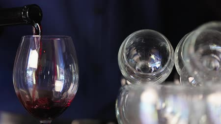 şarap kadehi : Wine. Closeup Of Red Wine Pouring Into Glass From Bottle