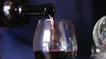 winemaking : Wine. Closeup Of Red Wine Pouring Into Glass From Bottle