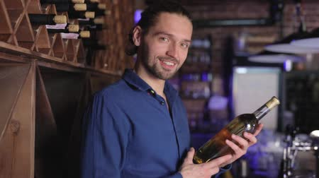 аперитив : Man Holding Bottle Of Wine At Wine Cellar