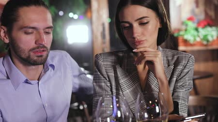 üzgün : Communication Problem. People Using Phone On Date At Restaurant Stok Video
