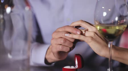 fiancee : Marriage Proposal. Closeup Man Wearing Ring On Womans Hand