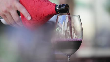 porce : Red Wine. Waiter Pouring Wine In Glass At Restaurant Closeup