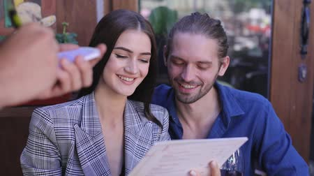 официант : Couple At Restaurant. People With Menu Making Order At Cafe
