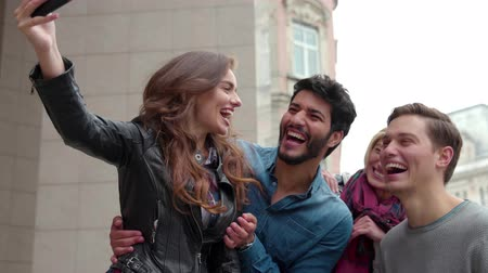 air kiss : Happy People Using Mobile Phone At Street. Friends Using Smartphone For Video Communication Stock Footage