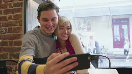 Video Call. Happy Couple In Cafe Using Phone For Video Chat